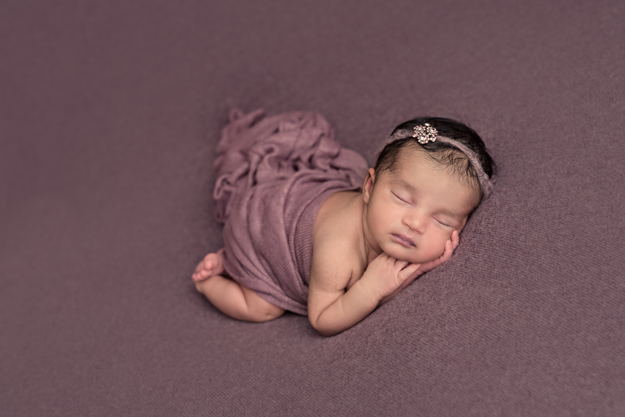 pretty little baby girl newborn photography session at a specialist studio in hamoshire