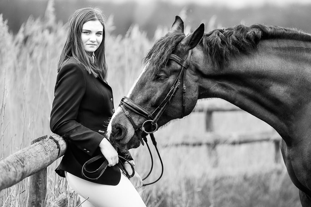 black-and-white-image-of-a-dressage-rider-and-her-horse