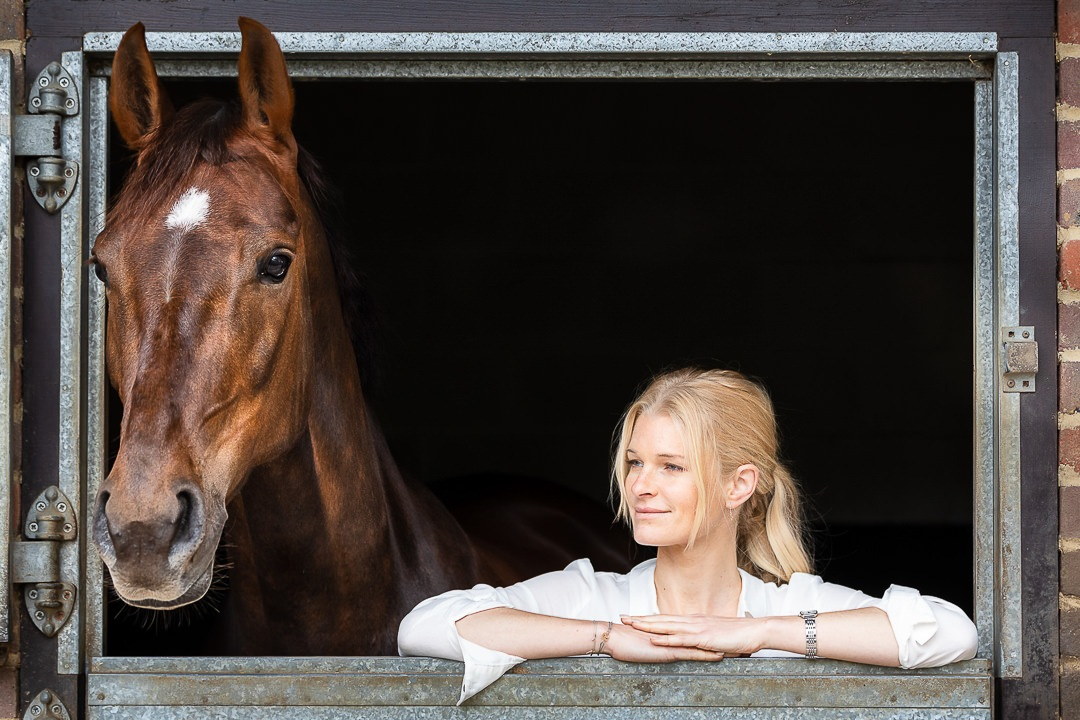 lady-and-her-dressage-horse-leaning-over-a-stable-door
