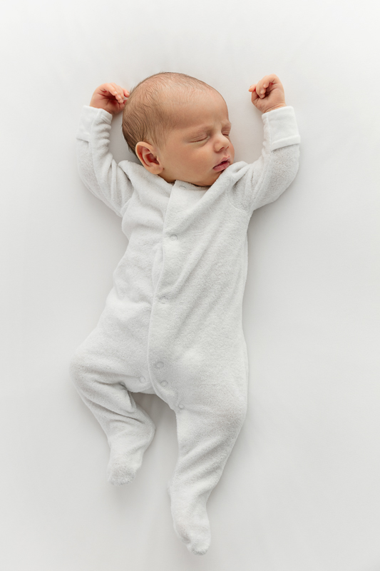 tiny-newborn-baby-in-a-pure-white-baby-photography-studio