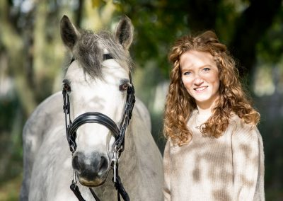 lady and her horse in an autumnal setting