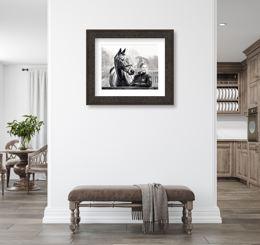 bold black and white framed equine photography image hanging on the wall in a modern house