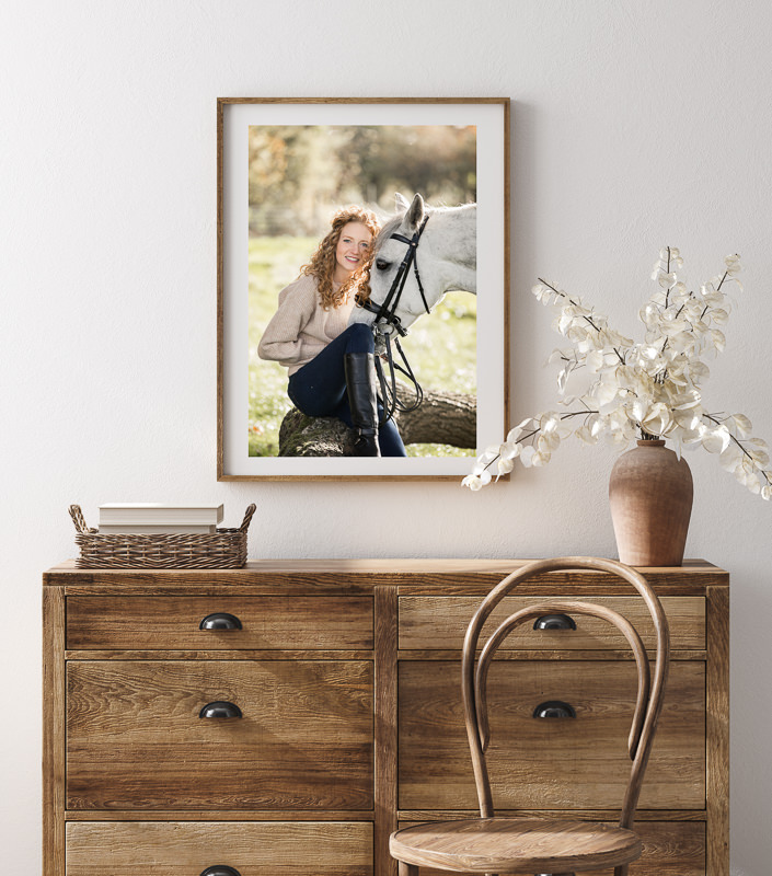 beautiful autumn equine photoshoot image hanging on a wall over a wooden dresser