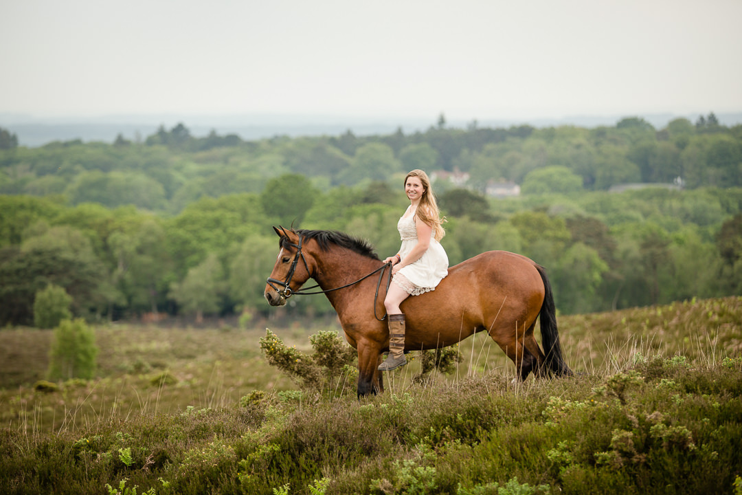 girl sitting on her pony in the new forest