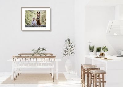 White modern kitchen with an equine portrait hanging on the wall