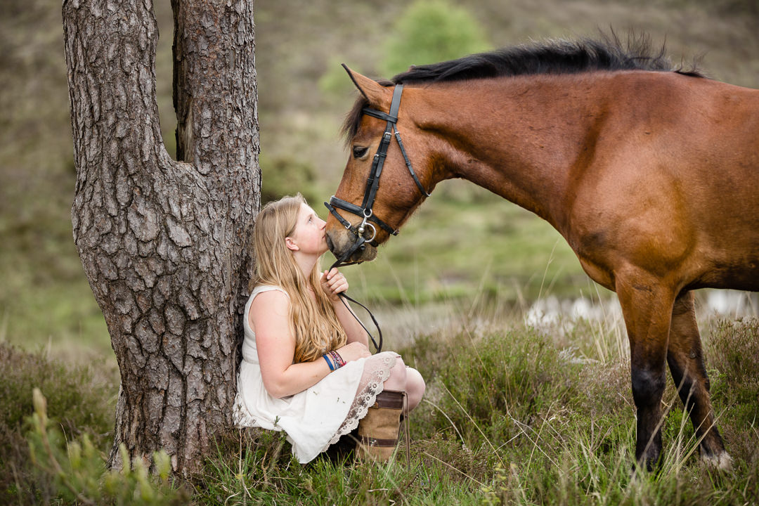girl and pony having a kiss in the new forest